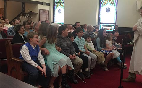 children-in-front-rom-during-church-service