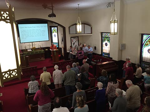 parishioners-standing-during-service