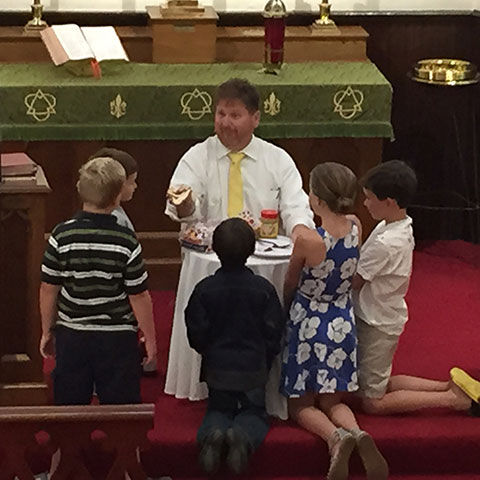 pastor-with-children