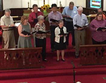 Choir singing from pew